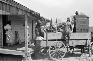 GEORGIA: DAY LABORERS. A day laborer loading his possessions on a wagon near Madison