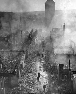 GERMAN RUINS, 1945. U.S. infantrymen move down a street in Waldenburg, Germany, after