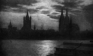 GERMANY: COLOGNE, c1920. The Rhein River and Cologne Cathedral in the evening at Cologne