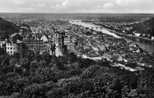 GERMANY: HEIDELBERG, c1920. View of the city of Heidelberg including Heidelberg Castle