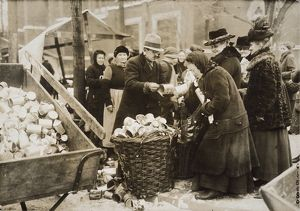 GERMANY: INFLATION, 1923. Berliners selling tin cans for scrap during severe inflation