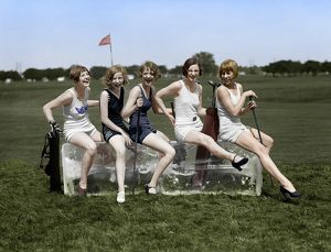 digitally colorized/golfing 1926 women wearing bathing suits sitting