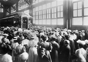 GOSPEL CAR, c1910. A crowd in a train shed at a railroad station, probably in or