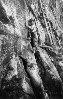 GRAND CANYON: CLIMBER. Photographer Ellsworth Kolb scaling a wall of rock 400 feet