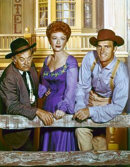 GUNSMOKE, c1960. Cast members Milburn Stone, Amanda Blake, and Dennis Weaver in a