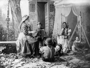 GYPSYIES, c1902. 'Happy Romanies.' A staged rendition of musicians in a gypsy camp