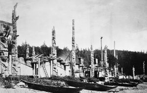 HAIDA VILLAGE, 1878. Totem poles and canoes in the Haida village of Skidegate in