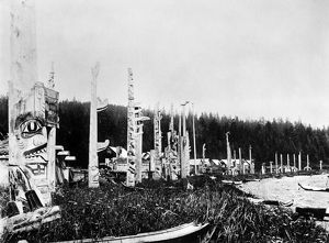 HAIDA VILLAGE, c1880. Totem poles and canoes in the Haida village of Skidegate