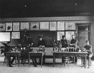 HAMPTON INSTITUTE, c1900. An agriculture class studying plant seeds at Hampton Institute
