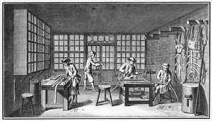 HARNESS-MAKER, 18th CENTURY. A harness-making shop, with workers cutting, punching