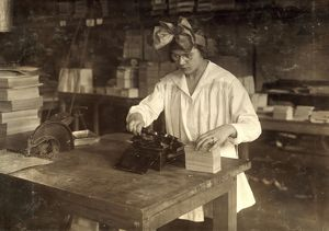 HINE: BOSTON INDEX CARD CO. A girl stamping labels at the Boston Index Card Co