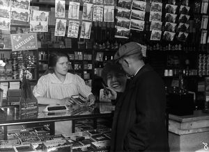 HINE: CIGAR STORE, 1917. 14-year-old Mary Creed selling cigars in a store in Boston
