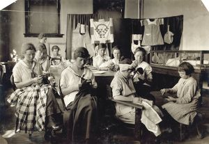 HINE: CLASSROOM, 1917. Sewing class at the Training School for Deaf Mutes in Sulphur