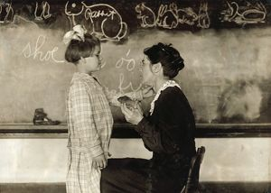 HINE: CLASSROOM, 1917. Teaching a deaf-mute how to talk at the Training School