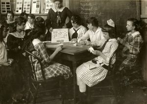 HINE: CONTINUATION SCHOOL. Young women studying textiles at a continuation school
