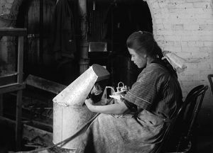HINE: FLOWER FACTORY, 1917. 14-year-old Margaret Reddington powdering roses with