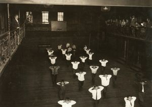 HINE: GYM CLASS, 1910. Boys exercising in a gym class at the Henry St