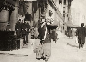 us cities/hine home industry 1912 woman carrying bundle