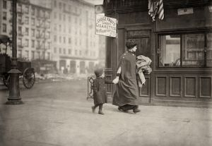 us cities/hine home industry 1912 woman son carrying