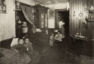 HINE: MILL HOUSING, 1912. An Italian American mother and five children in their