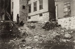 HINE: MILL HOUSING, 1912. Poor housing conditions for textile mill workers in Woonsocket