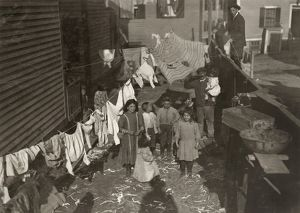 HINE: MILL HOUSING, 1912. Textile mill worker's family in the yard with a clothesline