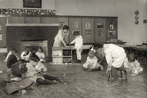 HINE: KINDERGARTEN, 1917. Children making wooden doll house pieces in a kindergarten