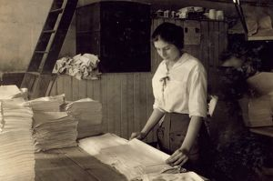 HINE: LAUNDRY, 1917. A 15-year-old girl folding laundry at the Bonanno Laundry in Boston