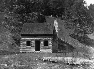 HINE: LOG CABIN, 1921. A small abandoned log cabin on the hillside in Pocahontas County
