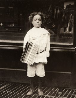 HINE: NEWSBOY, 1910. A newsboy selling newspapers around saloon entrances on the