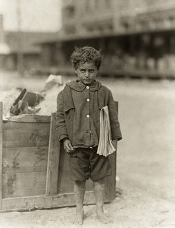 HINE: NEWSBOY, 1913. Four-year-old newsboy selling newspapers barefoot in Tampa, Florida