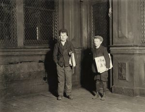 HINE: NEWSBOYS, 1912. Two illiterate newsboys working on a Saturday night until 3 A