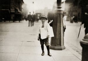 HINE: NEWSBOYS, 1912. A six-year-old newsboy selling paper in Washington, D