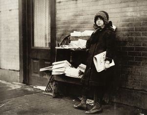 HINE: NEWSGIRL, 1912. A ten-year-old newsgirl tending a newstand on 4th and Garden