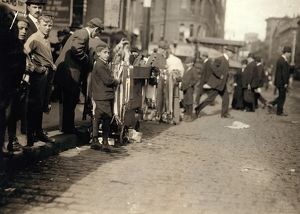 HINE: PEDDLERS, 1909. Boys peddling notions on the street in Boston, Massachusetts