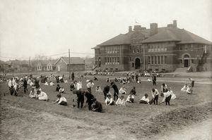 HINE: SCHOOL GARDEN, 1917. School children planting a large garden in the front