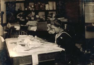 HINE: SEAMSTRESS, 1917. 15-year-old Marie Vancanvenberg working on corsets for