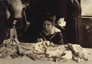 HINE: SEAMSTRESS, 1917. 16-year-old Helen Anderson sewing gowns for Madame Robinson