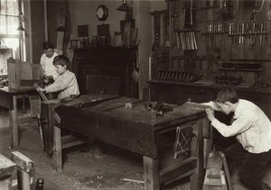 HINE: SHOP CLASS, 1910. Boys learning carpentry in a woodwork shop class at the Henry St