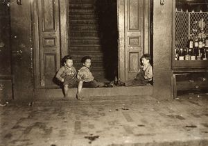 us cities/hine street boys 1909 boys hanging doorway