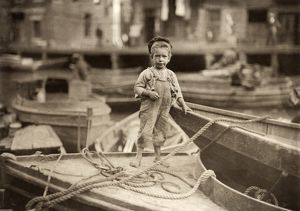 us cities/hine truant 1909 young truant hanging fishing