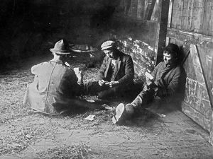 HOBOS, c1915. A group of hobos playing cards in a boxcar. Photograph, c1915