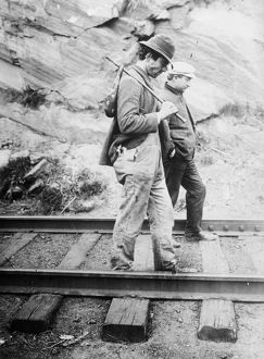 HOBOS, c1920. Hobos walking along the railroad tracks, after being kicked off the train
