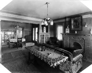 HOME INTERIOR, c1917. Living room and dining room of a working class home in Oklahoma City