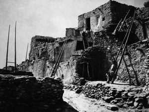 HOPI VILLAGE, 1879. A view of terraced houses in the Hopi village of Walpi, in