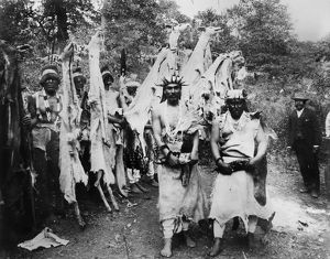 HUPA DANCE, 1897. Two Hupa chiefs carrying sacred obsidian knives in front of a