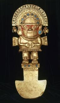 INCAN GOLD ORNAMENT. Incan spade-like gold ornament topped with a figure of a man