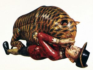 INDIA: TIGER ATTACK. Wooden sculpture of a tiger attacking an employee of the East India Company