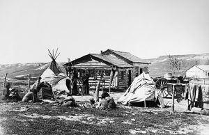 INDIAN CAMP, c1900. Native Americans at their camp, possibly Cree. Photograph, c1900