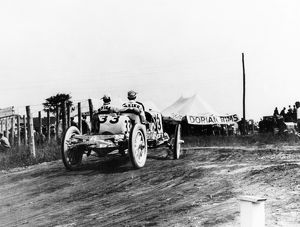 INDIANAPOLIS 500, 1911. Second-place finisher Ralph Mulford driving a Lozier during